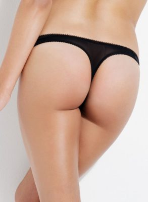 The L'Agent Penelope thong is crafted in sleek black sculptured stretch woven satin with panels of power mesh, giving incredible style and shape.