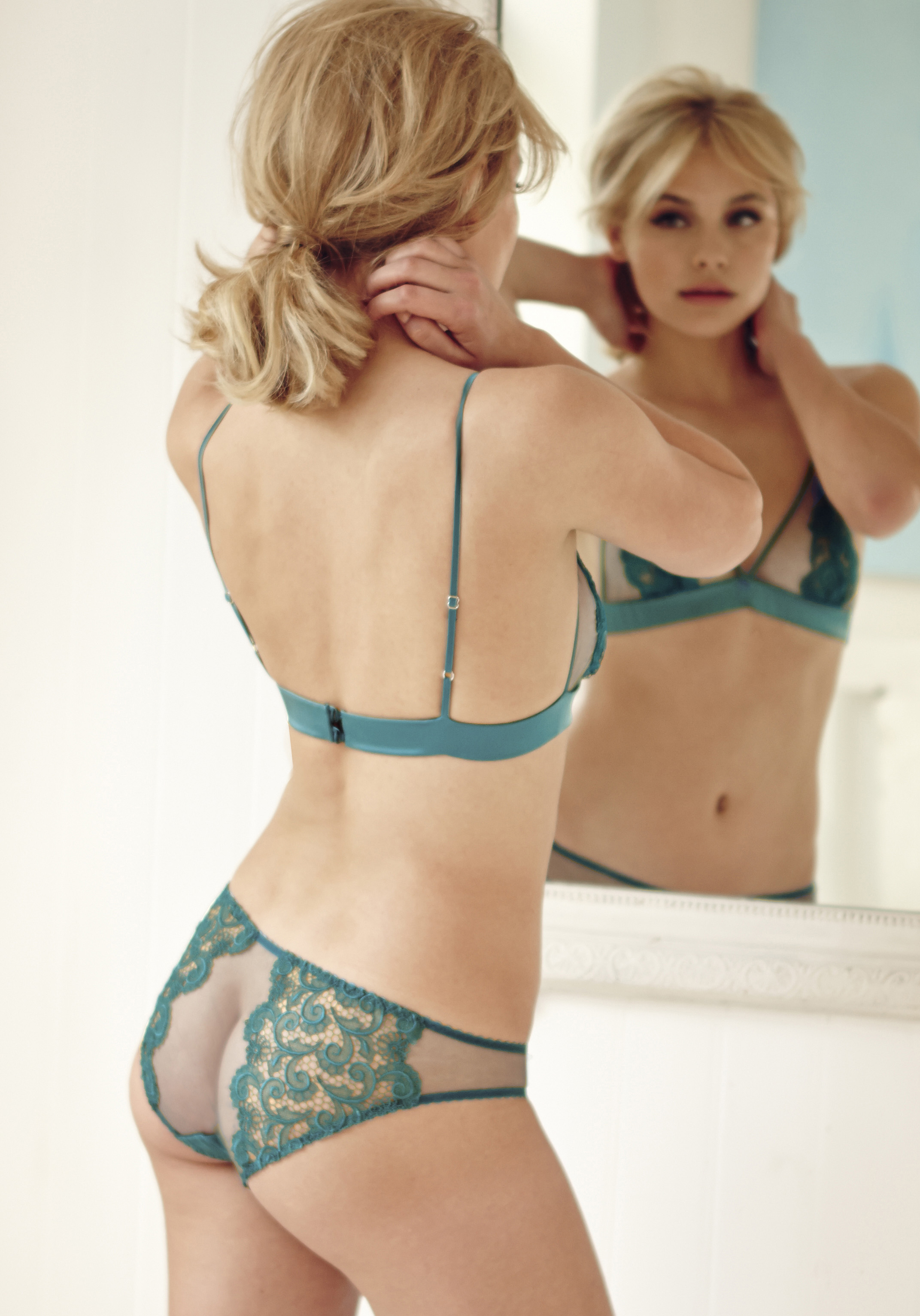 2eaeca63796 Beautiful hand-cut guipure lace embroidered panels in an opulent teal silk  combine with delicate