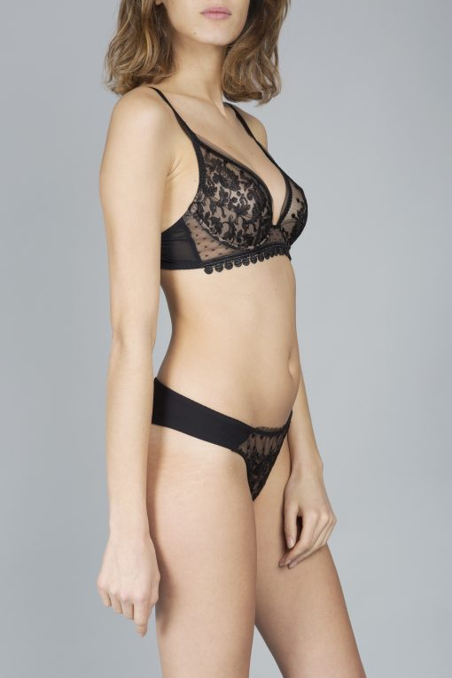 This irresistible Baisers de Paris black triangle bra is made in France, exuding the highest quality and craftsmanship.