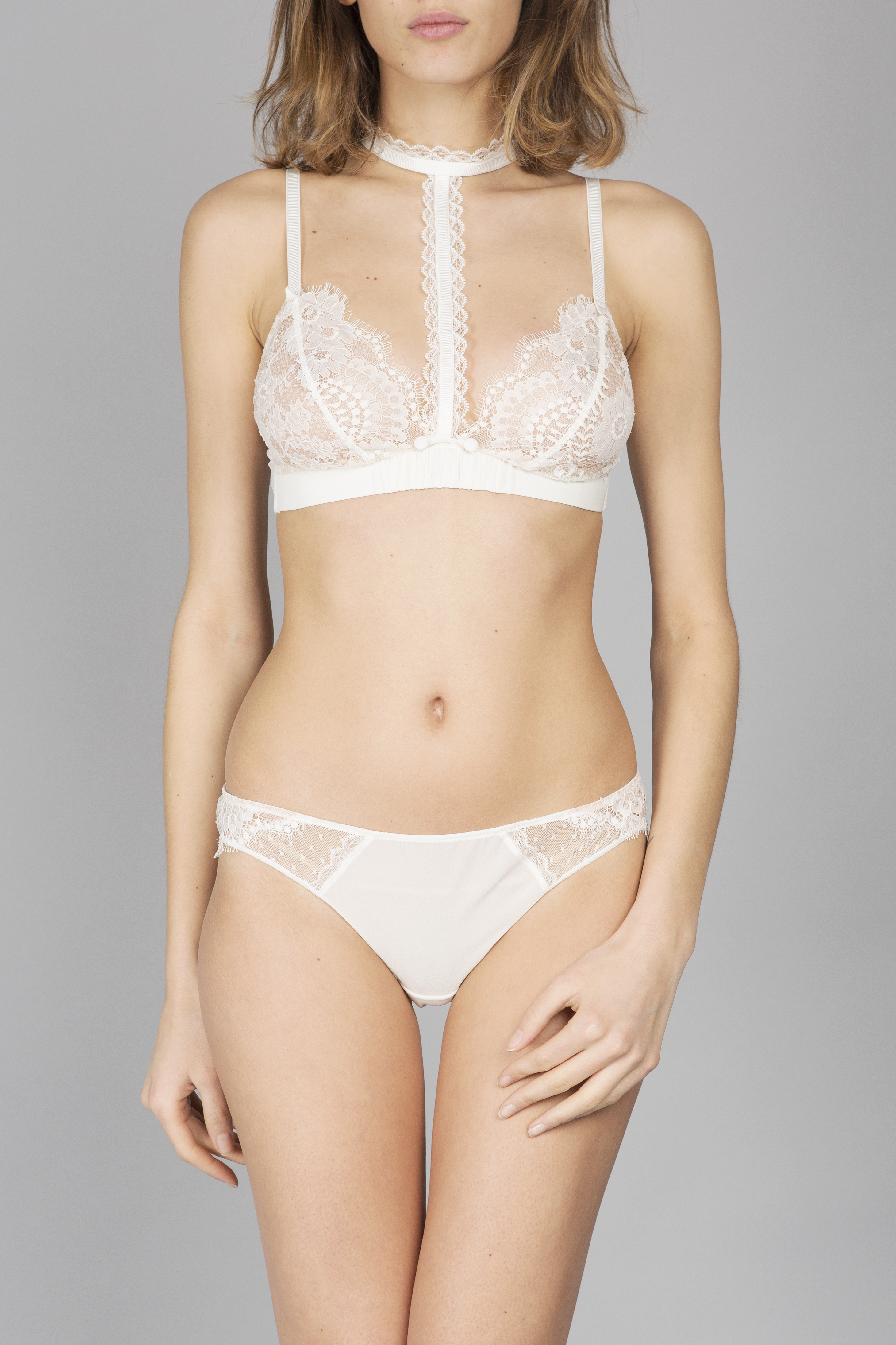 a99dbfd78 This beautiful Oui Lejaby triangle bra is intricately made in France from white  silk and Leavers