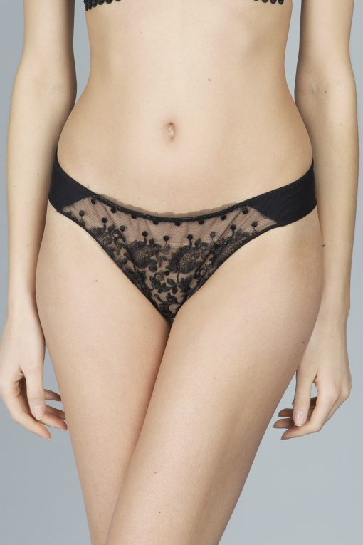 This irresistible Baisers de Paris black tanga brief is made in France from a raw-cut tulle trim for a lighter look.