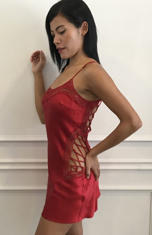 Make sure all eyes are on you in this captivating Marjolaine red silk Desire nightdress. The nightdress features a bold and sexy lace-up design on the back and sides that is guaranteed to attract attention.